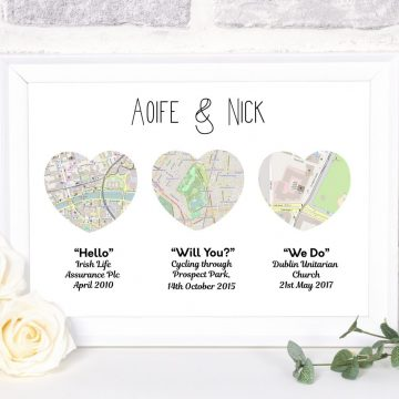 Three heart Shaped map prints acommpanied by the happy couples names above and  Met Engaged Married with places and dates of events