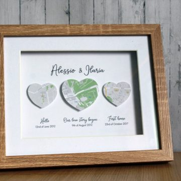 Three maps with meaning suspended in a shadow box frame